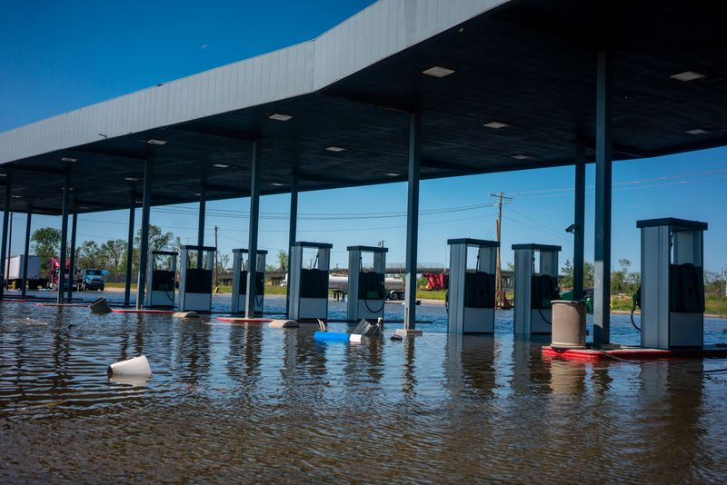 FILE PHOTO: A gas station remains flooded from Hurricane Delta in Lake Charles