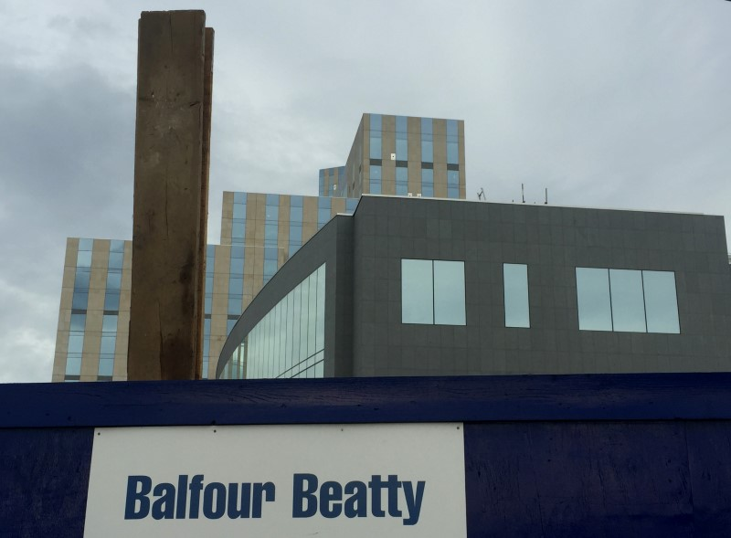 A sign of  Balfour Beatty is seen at a construction site in London
