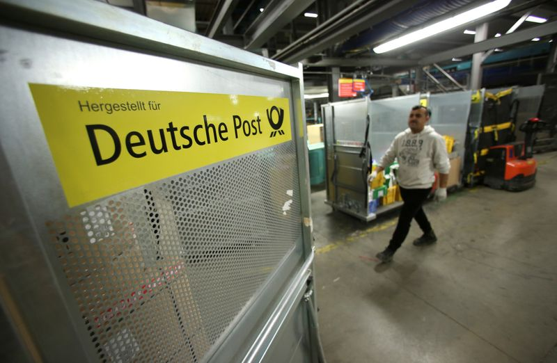 An employee works at a distribution centre of Deutsche Post DHL in Rodgau