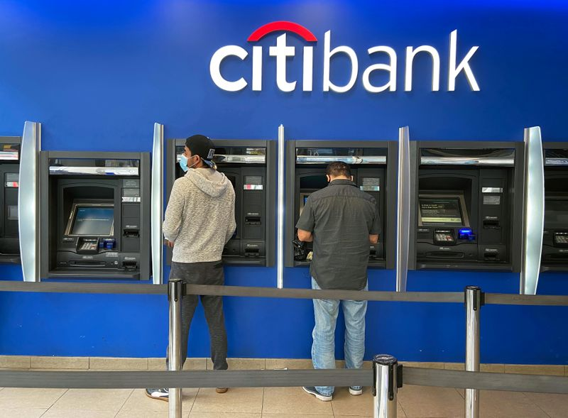 Customers use ATMs at Citibank branch in New York City