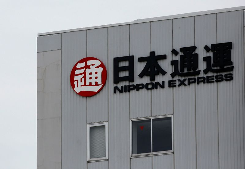 FILE PHOTO: The logo of Japanese transportation compnay Nippon Express Co. is displayed at the company's logistic facility in Tokyo