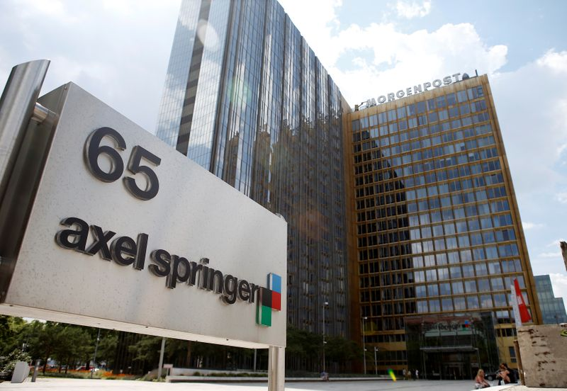 FILE PHOTO: The logo of German publisher Axel Springer is pictured in front of the company's headquarters in Berlin