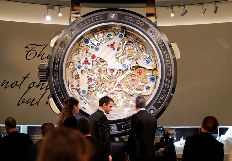 Visitors are pictured in the A. Lange & Soehne at the SIHH watch fair in Geneva
