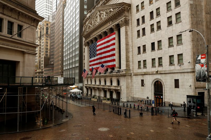 FILE PHOTO: United States flags fly outside of the NYSE as markets continue to react to the coronavirus disease (COVID-19) at the NYSE in New York