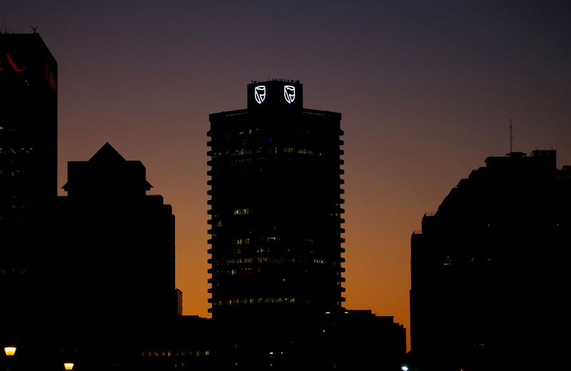 FILE PHOTO: The logo of South Africa's Standard Bank is seen above the company's offices in Cape Town