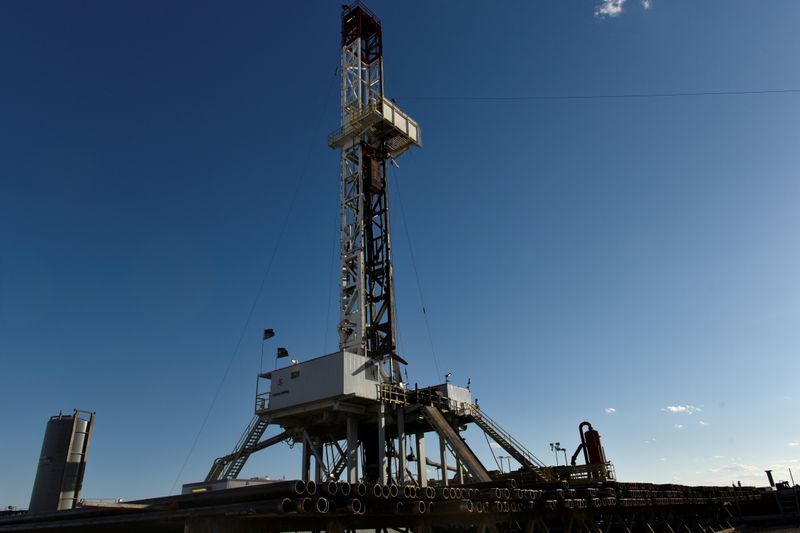 FILE PHOTO: A horizontal drilling rig on a lease owned by Parsley Energy operates in the Permian Basin near Midland