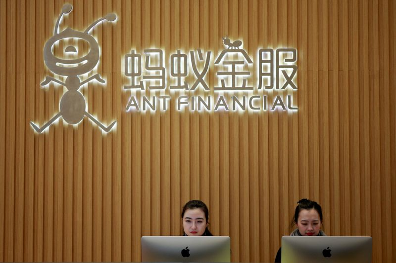 FILE PHOTO: FILE PHOTO: Employees are seen at the reception desk of Ant Financial Services Group at its headquarters in Hangzhou