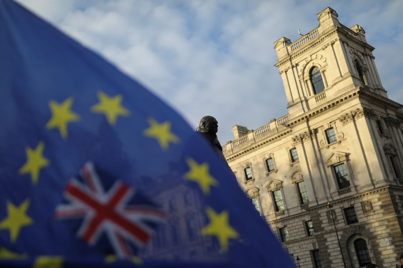 A flag is seen outside the Houses of Parliament near the statue of former Prime Minister Winston Churchill in London