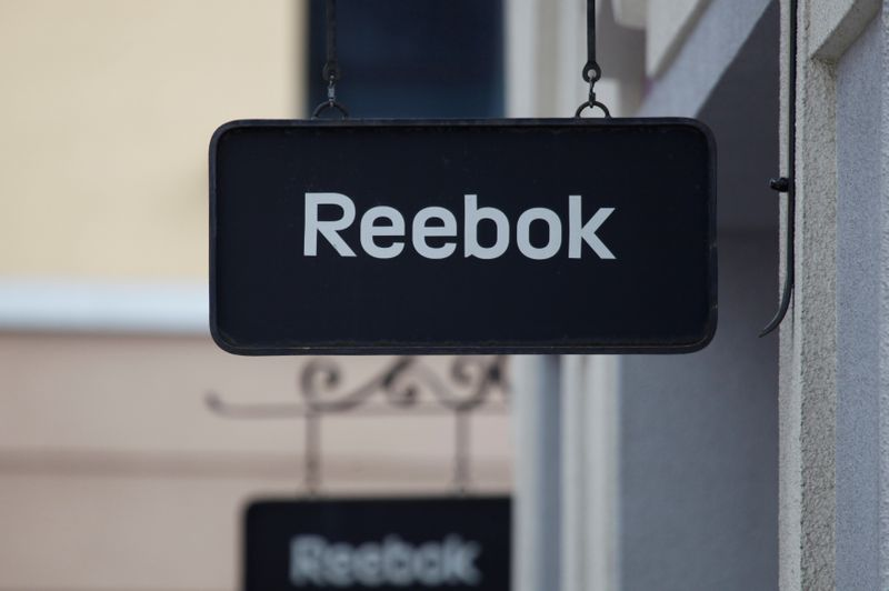 Boards with Reebok store logo are seen on a shopping center at the outlet village Belaya Dacha outside Moscow