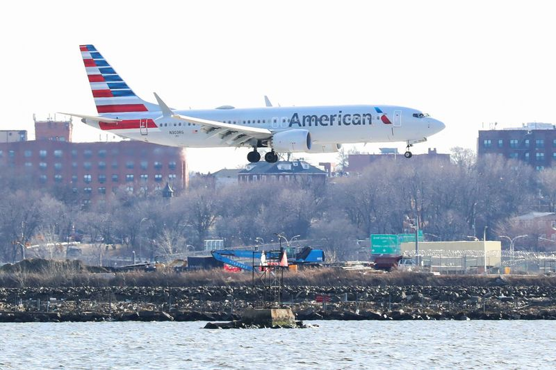 FILE PHOTO: An American Airlines Boeing 737 MAX 8 comes in for landing at LaGuardia Airport in New York