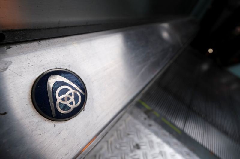 FILE PHOTO: The logo of German steelmaker ThyssenKrupp AG is seen on an escalator at Frankfurt's main railways station in Frankfurt