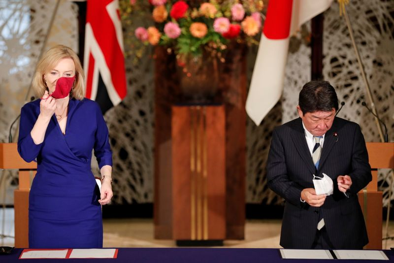 Britain's International Trade Secretary Elizabeth Truss and Japanese Foreign Minister Toshimitsu Motegi sign the UK-Japan Comprehensive Economic Partnership Agreement in Tokyo