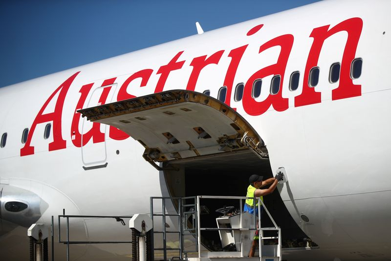 A worker checks an aircraft of Lufthansa's unit Austrian Airlines ahead of take off to New York at the Vienna International Airport in Schwechat