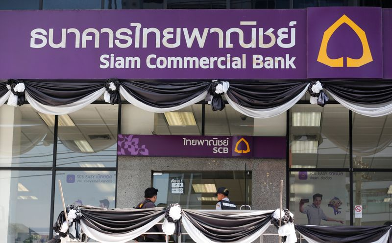 A man walk into the Siam Commercial Bank branch in central Bangkok