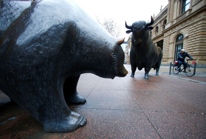 FILE PHOTO: Bull and bear statues are pictured outside Frankfurt's stock exchange