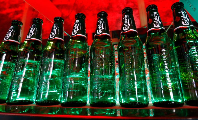 Bottles of Carlsberg beer are seen in a bar in St. Petersburg