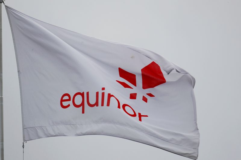 FILE PHOTO: FILE PHOTO: FILE PHOTO: Equinor's flag flutters next to the company's headqurters in Stavanger