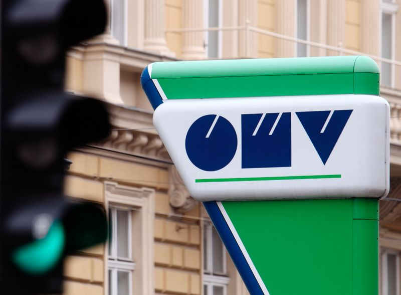 The Austrian oil and gas group OMV logo is pictured next to traffic lights at a gas station in Vienna