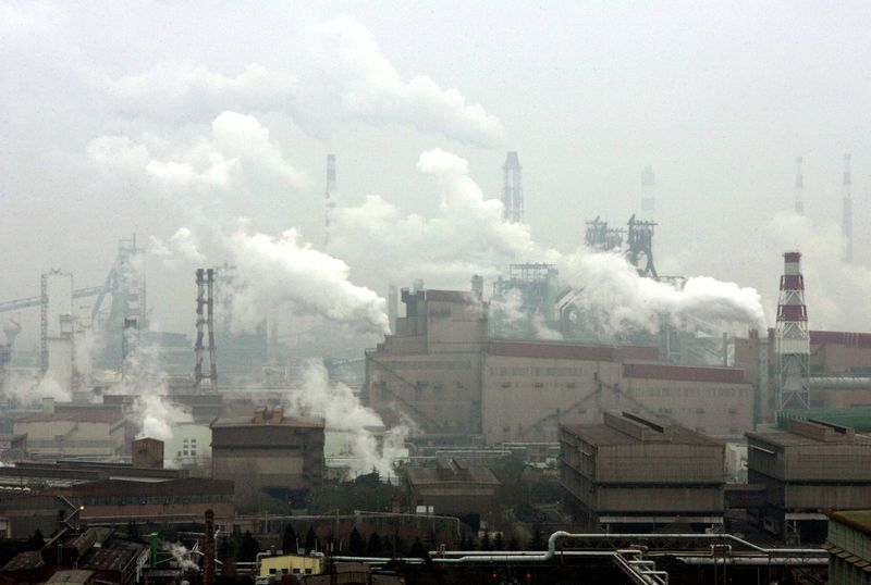 FILE PHOTO: Smoke billows from the Baosteel factory in Shanghai.