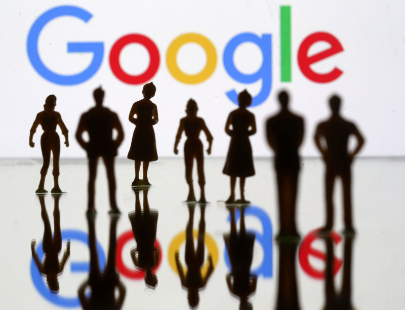 FILE PHOTO: FILE PHOTO: Small toy figures are seen in front of Google logo in this illustration picture