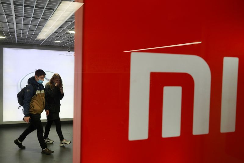 People wearing protective face masks visit Xiaomi brand's store in Kyiv