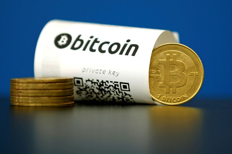 FILE PHOTO: An illustration photo shows a Bitcoin (virtual currency) paper wallet with QR codes and a coin are seen at La Maison du Bitcoin in Paris