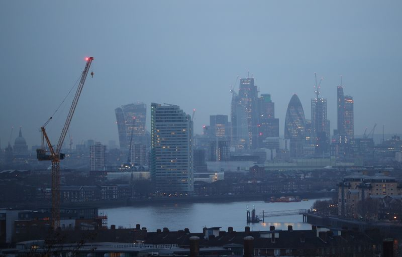FILE PHOTO:  The City of London financial district is seen during early morning mist from Greenwich Park in London