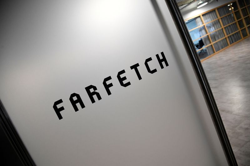 Branding for online fashion house Farfetch is seen at the company headquarters in London