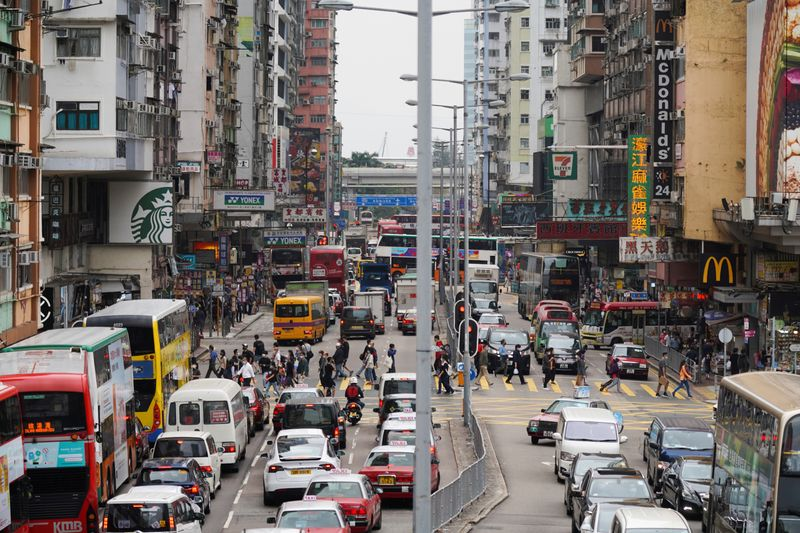 FILE PHOTO: People walk across a street at Mong Kok in Hong Kong