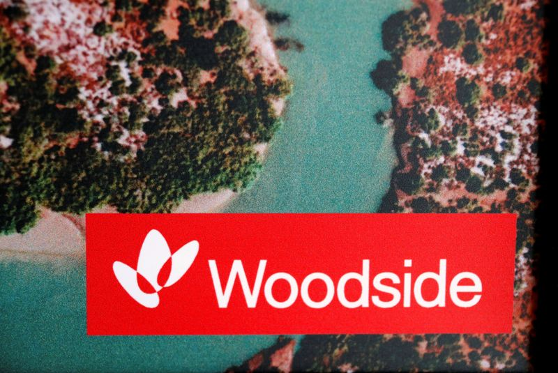 The logo for Woodside Petroleum, Australia's top independent oil and gas company, adorns a promotional poster on display at a briefing for investors in Sydney
