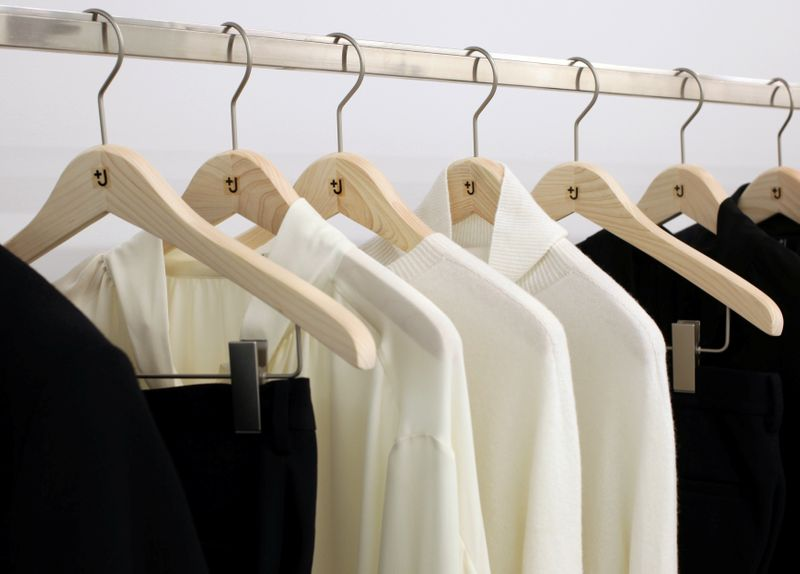 Clothes of collaborative label +J are displayed at Uniqlo's press room in Tokyo