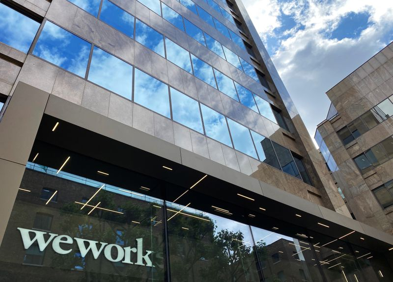 FILE PHOTO: The logo of WeWork is seen in the window of a building in London