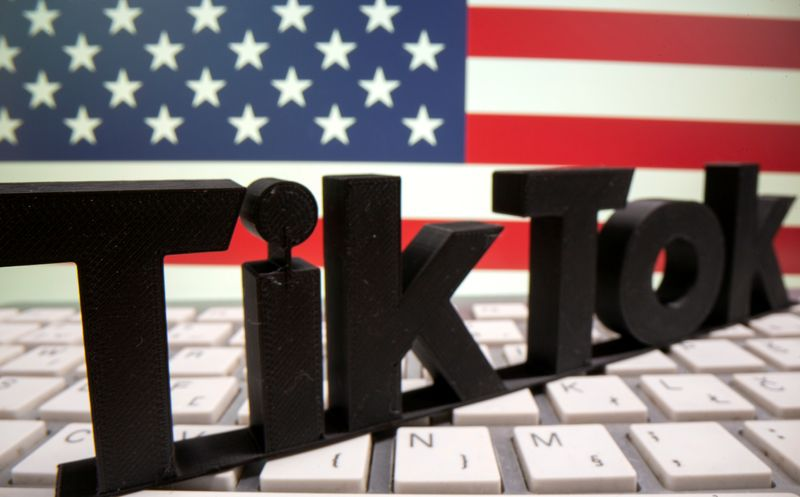 FILE PHOTO: A 3D printed TikTok logo is placed on a keyboard in front of U.S. flag in this illustration