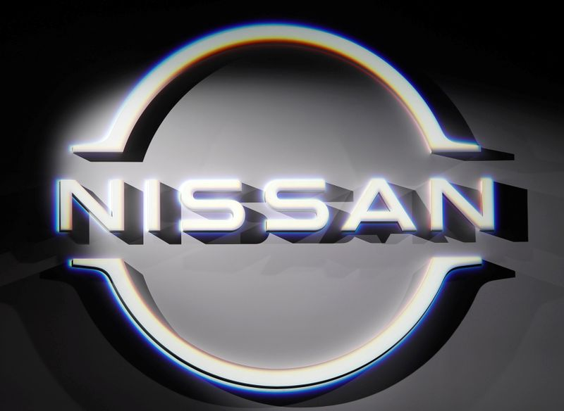FILE PHOTO: The brand logo of Nissan Motor Corp. is displayed during a press preview of the company's new Ariya all-battery SUV in Yokohama