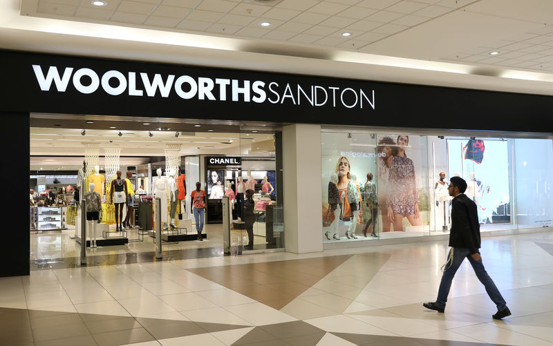 A shopper walks to a Woolworths store in Sandton