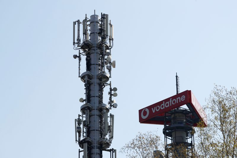 Different types of 4G, 5G and data radio relay antennas for mobile phone networks are pictured on relay masts operated by Vodafone in Berlin