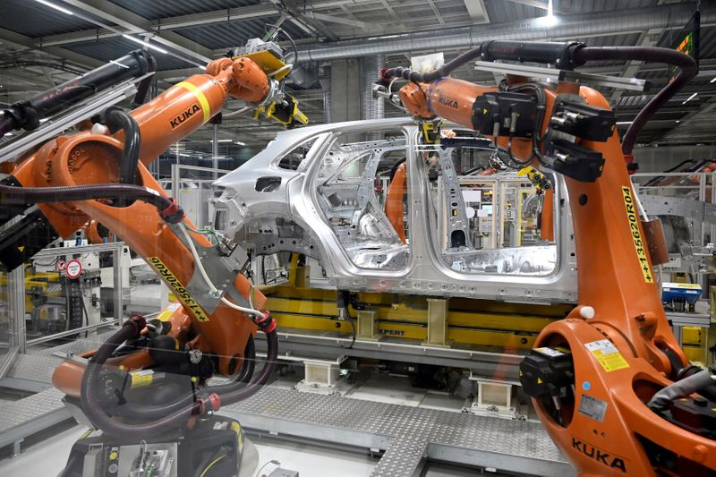 FILE PHOTO: Robotic arms on an assemby line at Volkswagen's construction plant in Bratislava, Slovakia