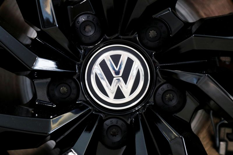 FILE PHOTO: The logo of German carmaker Volkswagen is seen on a rim cap in a showroom of a Volkswagen car dealer in Brussels
