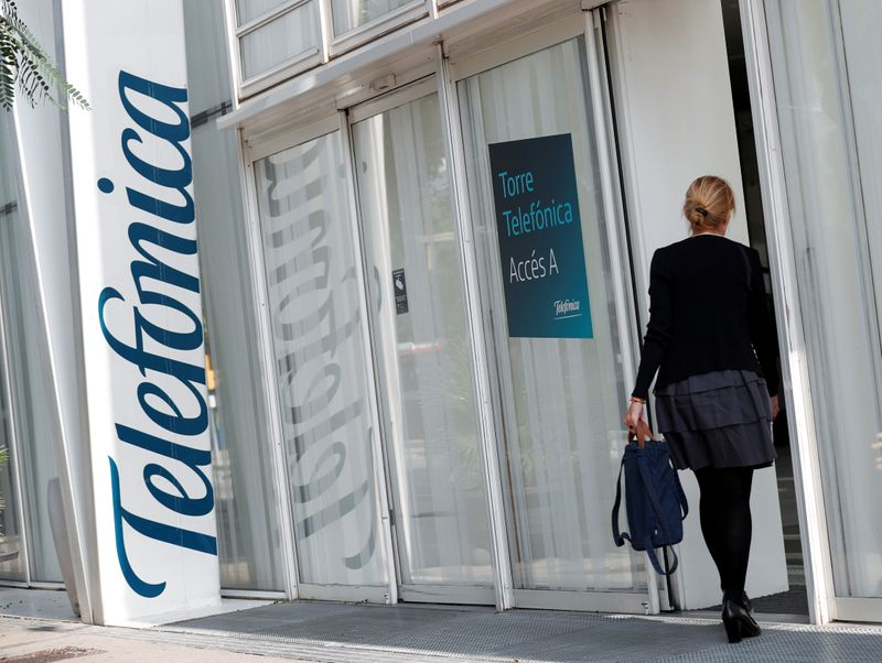 A woman walks into a Telefonica office building in Barcelona