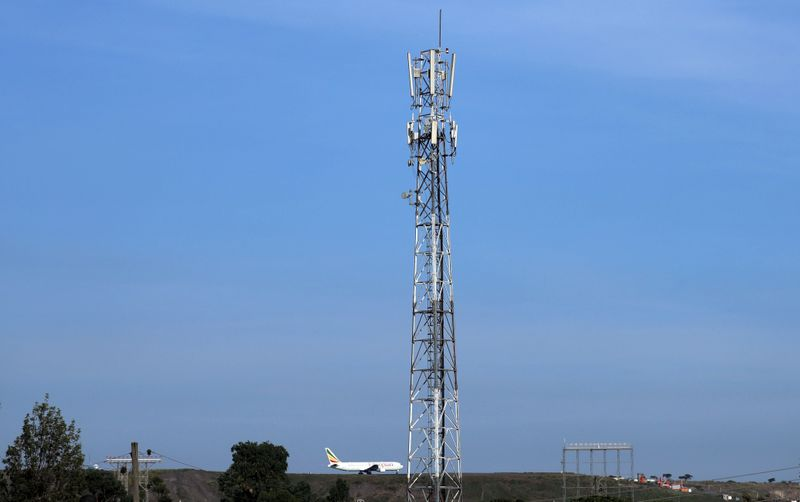FILE PHOTO: An Ethiopian Airlines plane prepares to takeoff next to an Ethio-Telecom network tower in Addis Ababa