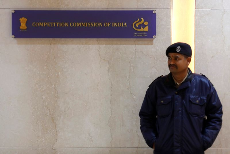 FILE PHOTO: A security guard stands outside the Competition Commission of India (CCI) headquarters in New Delhi