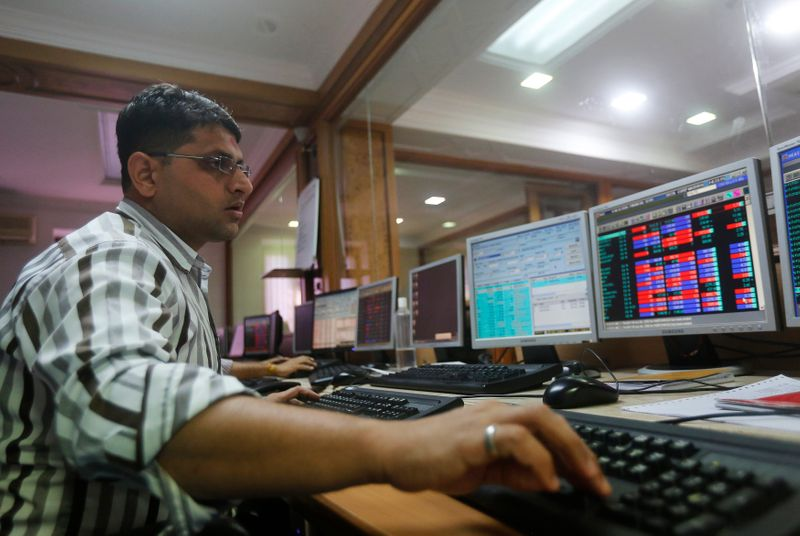 A broker trades on his computer terminal at a stock brokerage firm in Mumbai