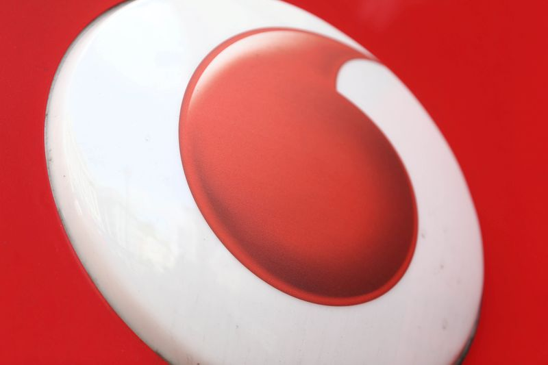 FILE PHOTO: A branded sign is displayed on a Vodafone store in London