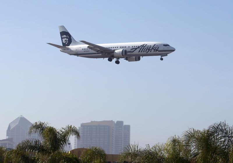 FILE PHOTO: An Alaska Airlines Boeing 737 plane is shown on final approach to land in San Diego