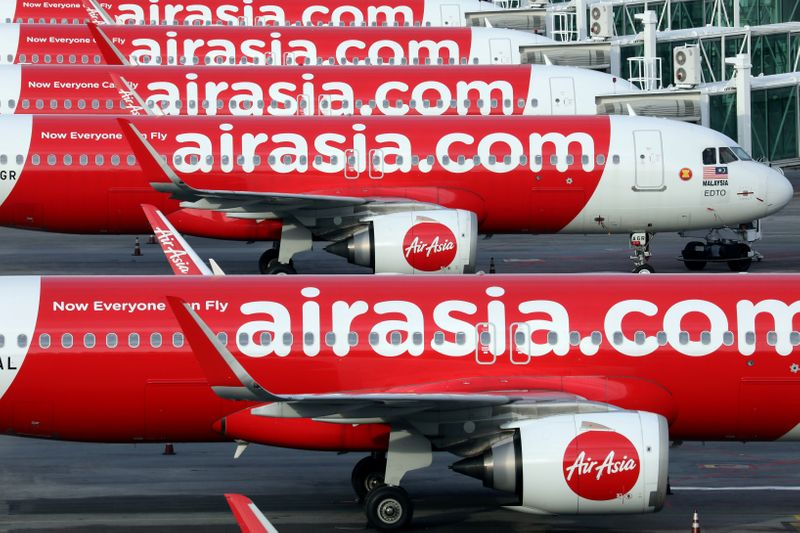 FILE PHOTO: Airasia planes are seen parked at Kuala Lumpur International Airport 2, amid the coronavirus disease (COVID-19) outbreak in Sepang