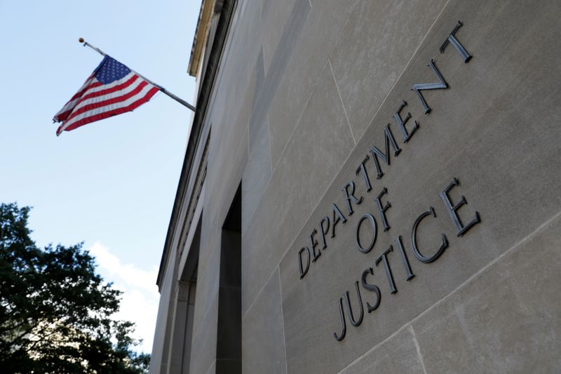 FILE PHOTO: Signage is seen at the United States Department of Justice headquarters in Washington, D.C.