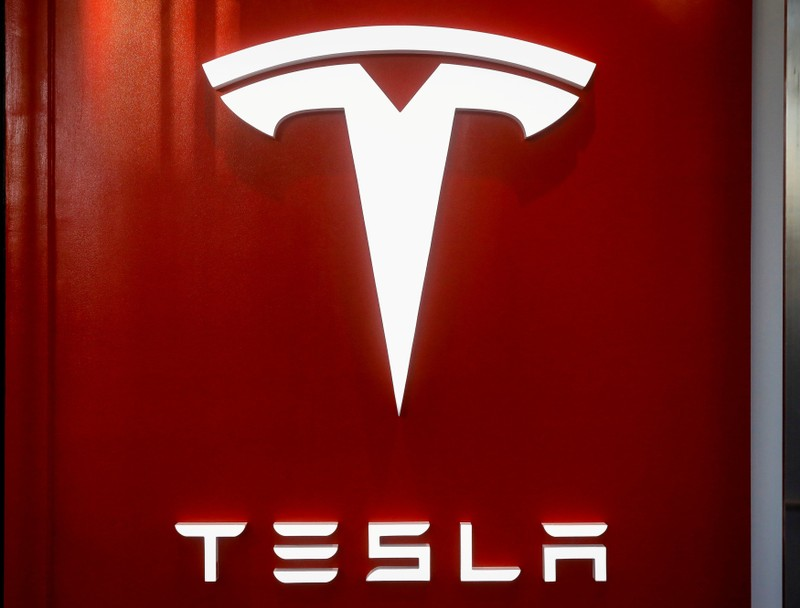 FILE PHOTO: The Tesla logo is seen at the entrance to Tesla Motors' showroom in Manhattan's Meatpacking District in New York City