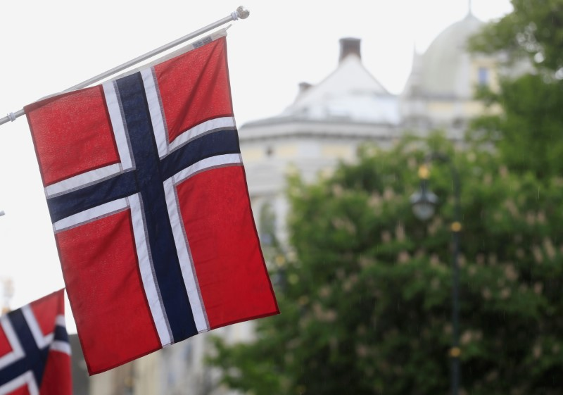 FILE PHOTO: Norwegian flags flutter at Karl Johans street in Oslo, Norway