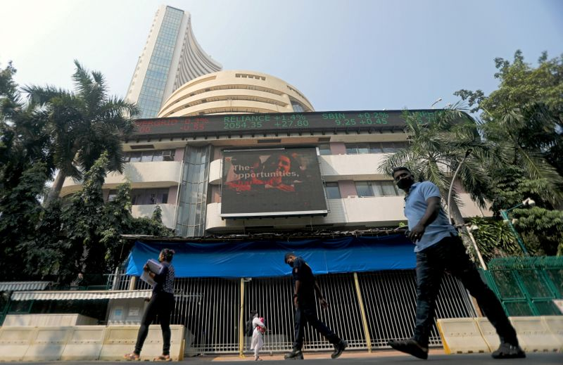 People walk past the Bombay Stock Exchange (BSE) building in Mumbai