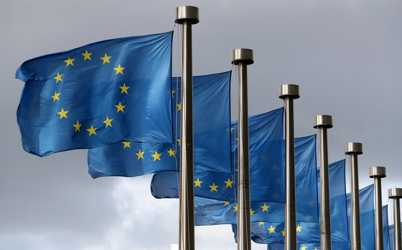 FILE PHOTO: EU flags flutter in front of the European Commission headquarters in Brussels